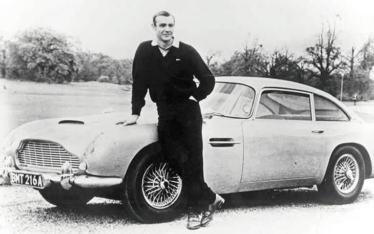 Sean Connery as James Bond, poses with Aston Martin DB5 - 1965