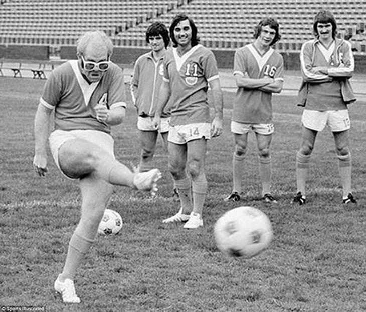 Elton John showing off his football skills, 1976