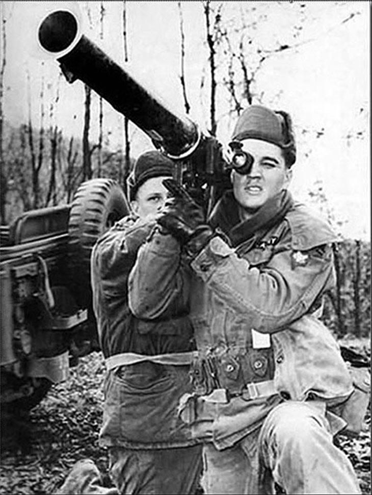 Elvis Presley with a bazooka in the U.S. Army, 1958