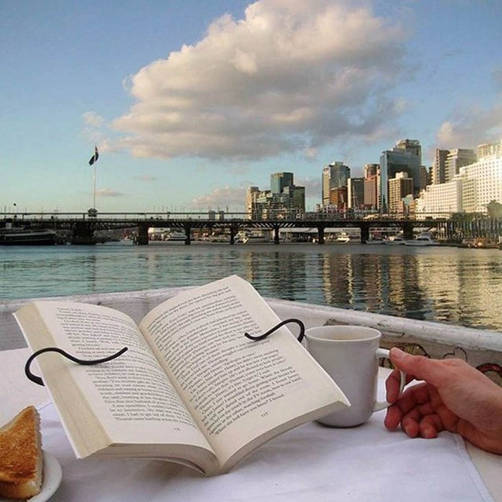 Hands-free book holder keeps your hands free while you read.