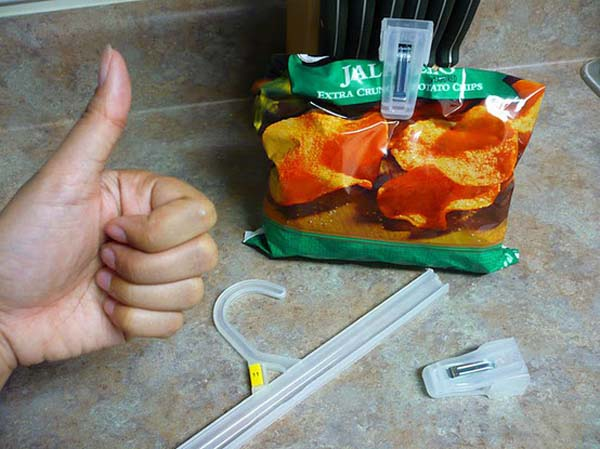 Use the pants hanger that no one ever use to close off bags of food.