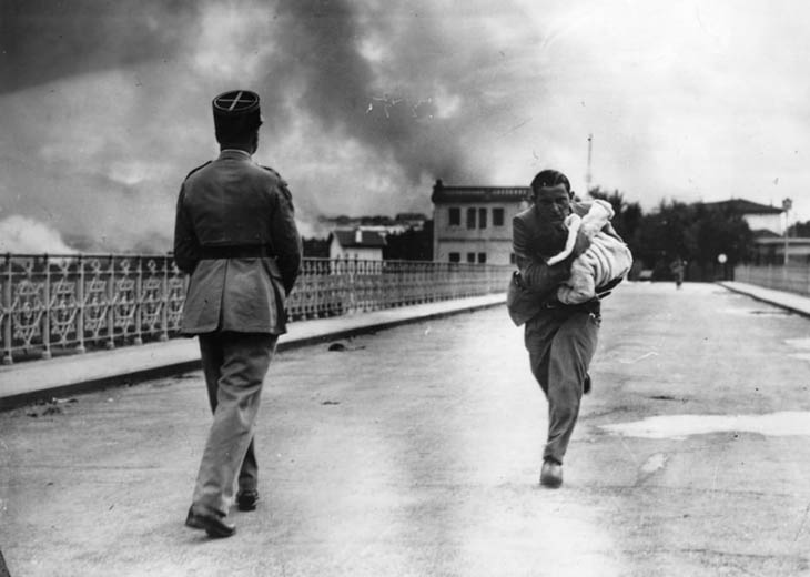 A journalist dashes across a bridge between to rescue a baby during Civil War in 1936.