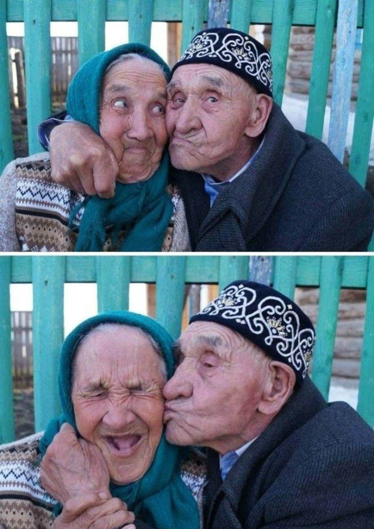 Old man kissing his wife.