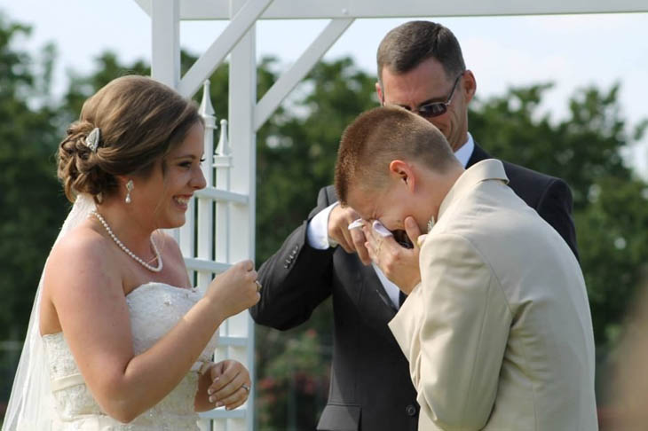 Groom crying tears of joy after seeing his bride for the first time.