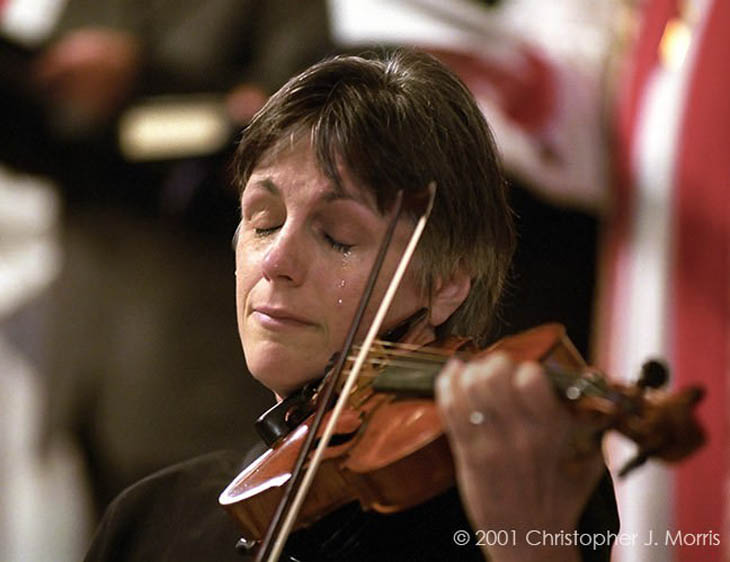 Violinist, Nancy Dinovo, cries while playing.