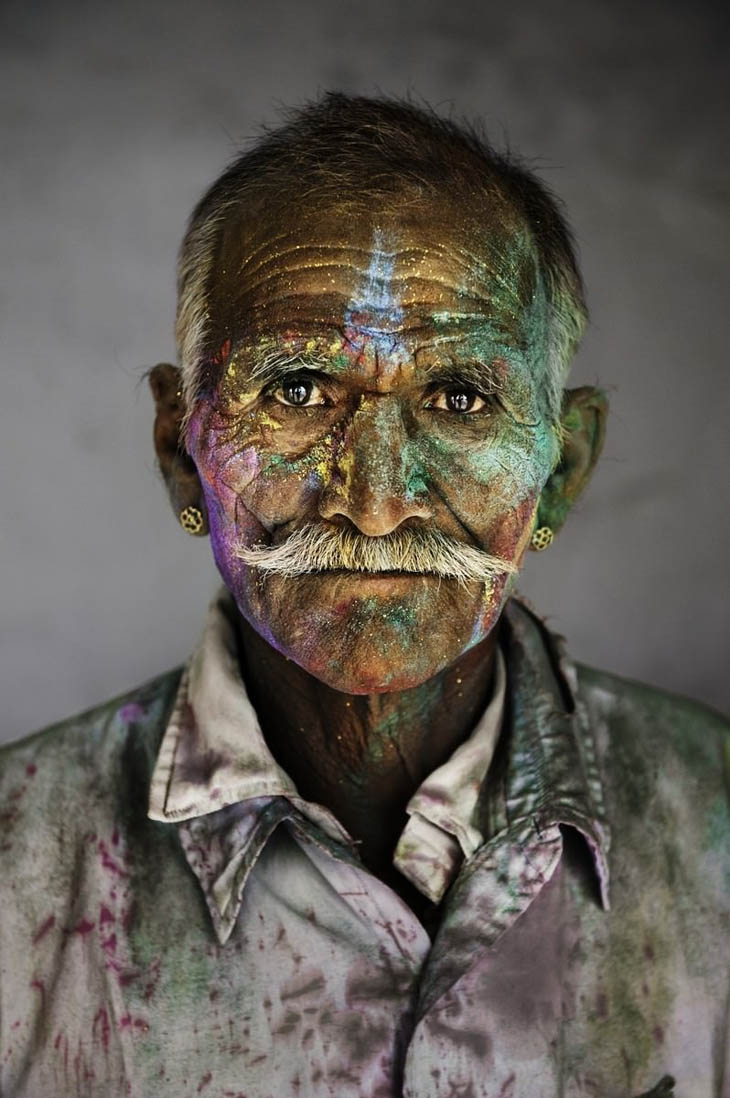 An Indian man in the festival of Holi (Festival of colors).