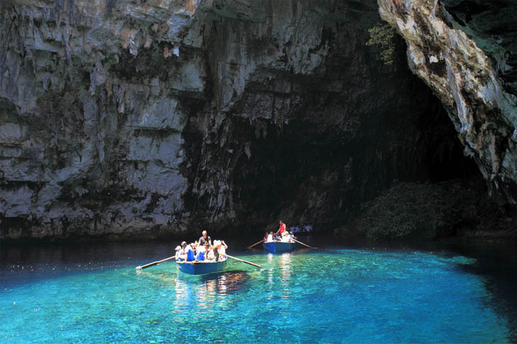 Rowing through a dark cave in Kefalonia, Greece.