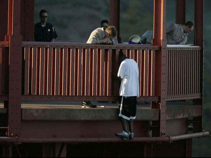 evin Berthia is talked out of jumping off the Golden Gate Bridge by police officers.