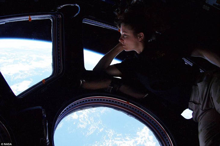 Tracy Caldwell looks down on Earth from the International Space Station [2010]