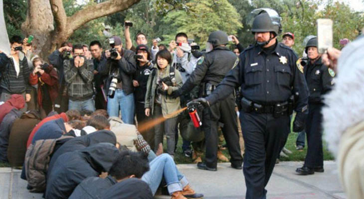 21st century photos - A police officer pepper-sprays Occupy protesters at the University of California