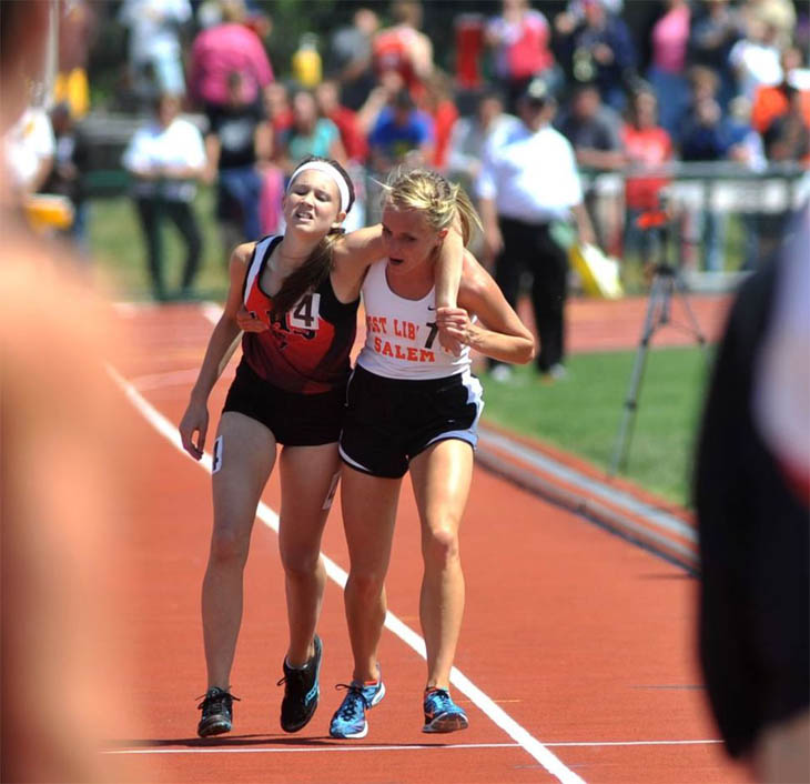 Meghan Vogel, a high school runner, helps her exhausted rival cross the finish line. [2012]