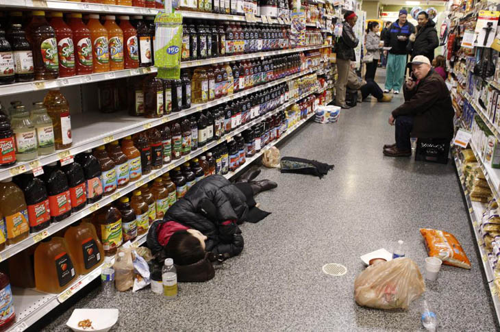 People hang out in a Publix grocery store after being stranded due to a snow storm in Atlanta, Georgia.