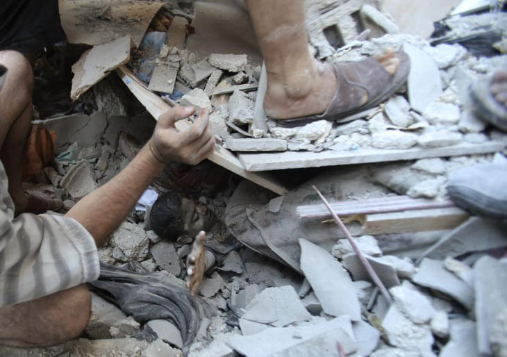 Palestinians rescue Mahmoud al-Ghol from under the rubble of a house in Rafah in the southern Gaza Strip.