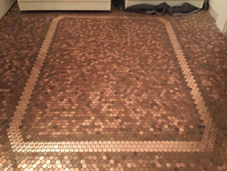 After gluing 20,000 pennies, the penny floor project was complete.