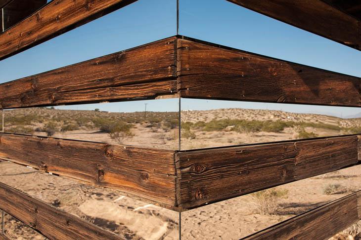 Look how Phillip arranged strip of mirror in between weathered board.