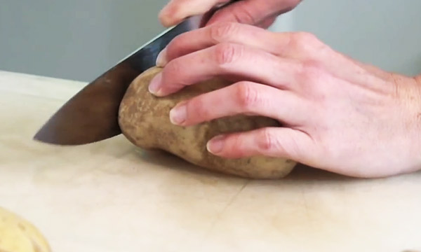 She Slices A Potato, But Not All The Way. Why? It's GENIUS!