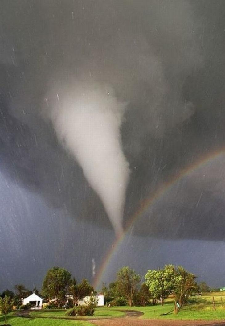 A tornado and rainbow converge over Kansas.