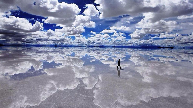 The giant salt flats in Bolivia make it appear as if you are walking on water.