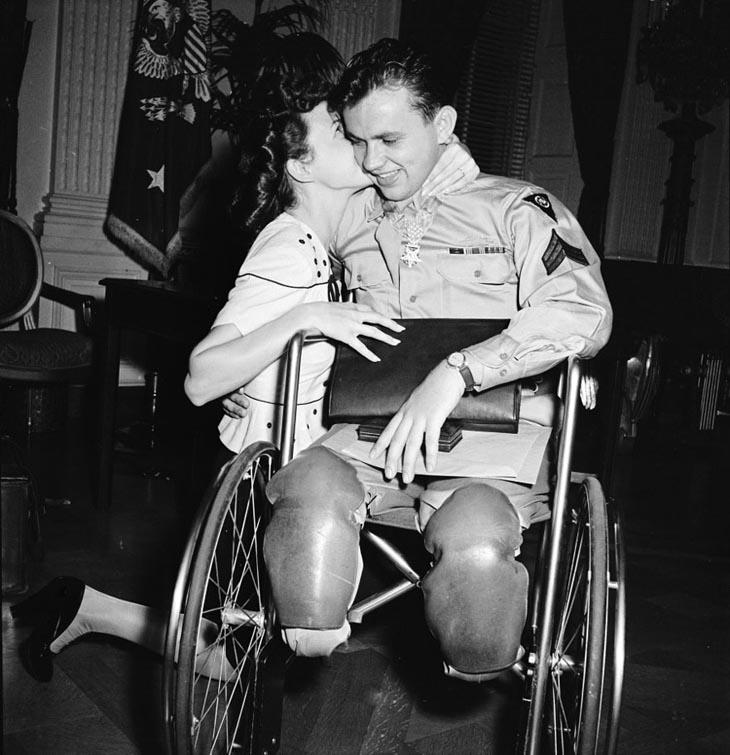 Wartime photos:Jean Moore Kneels And Kisses Her Fiancé, Wheelchair-Bound World War II Veteran Ralph Neppel, 1945